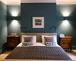 master bedroom with matching bedside tables and contemporary lighting