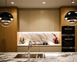 kitchen workspace with marble work surfaces and splashbacks
