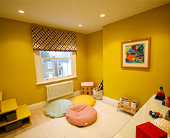 playroom with abstract art and roman blinds