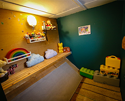child's playroom with diagonal wooden flooring